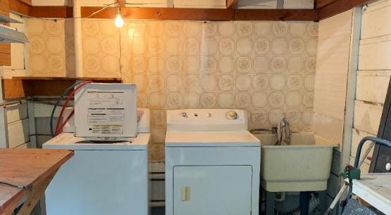 Laundry with extra storage, plus overhead shelf storage